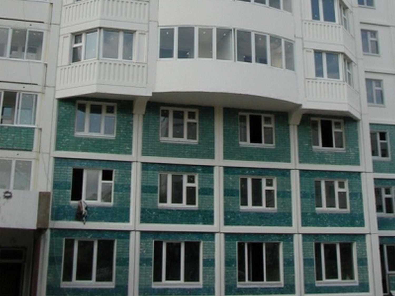 Жилой дом с отделкой офактуренным кирпичом
